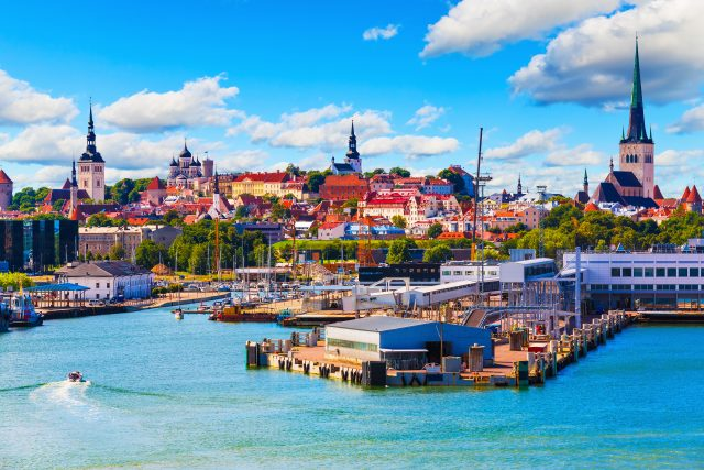 Scenic summer view of the Old Town and sea port harbor in Tallinn